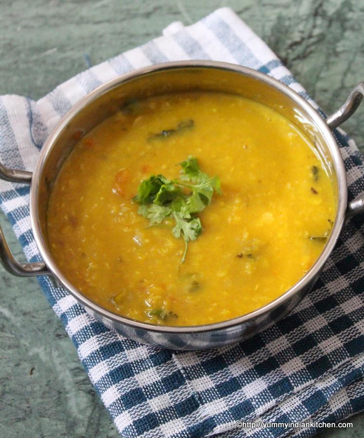 masoor dal recipe served in wok with coriander garnish