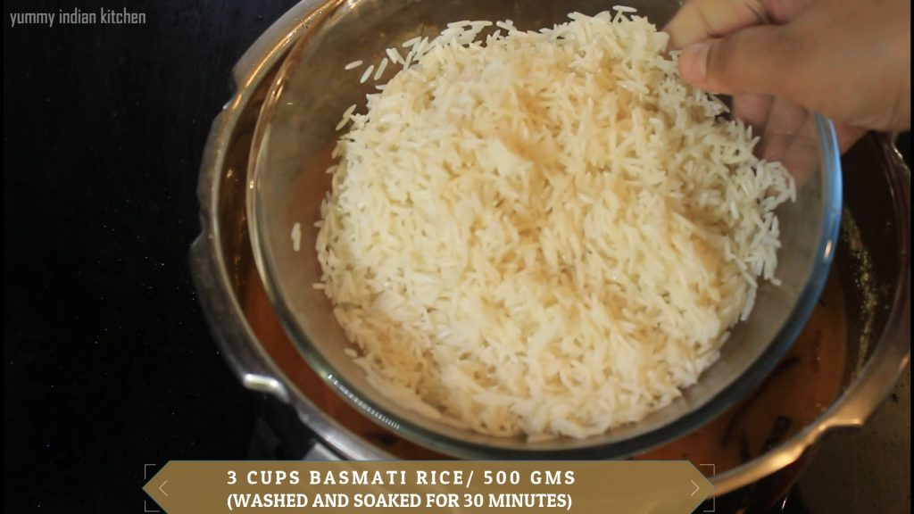 Adding the soaked basmati rice