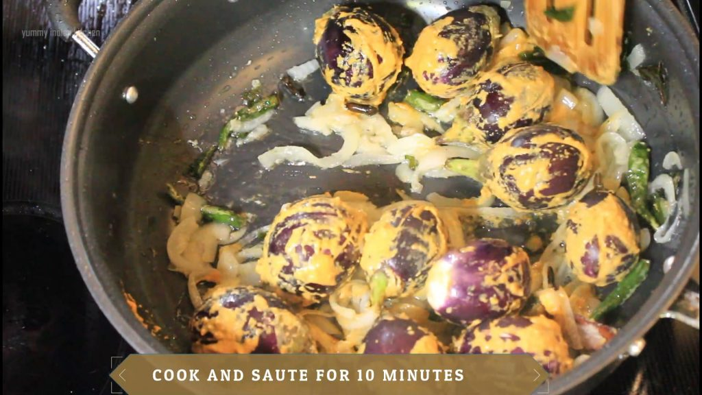 Stir frying gutti vankaya and cooking them for 8-10 minutes