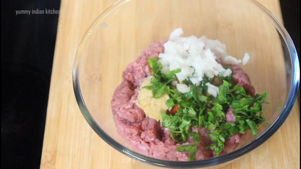 adding chopped green chili, chopped coriander leaves, chopped onions