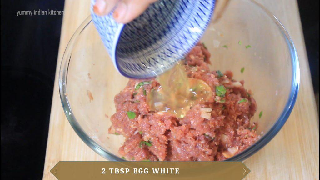 adding lemon extracted juice and egg white