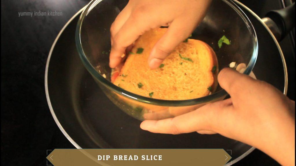 dip bread slice into the egg mixture.