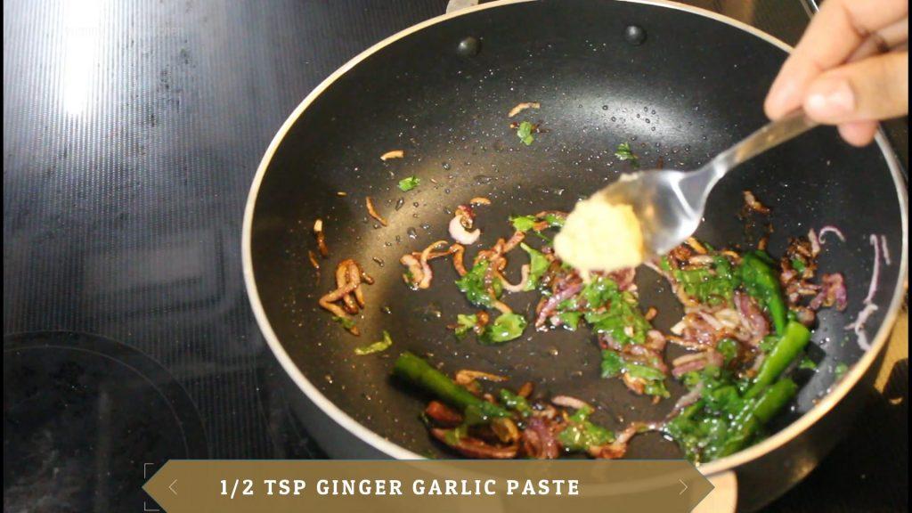 Adding ginger-garlic paste and sauteing