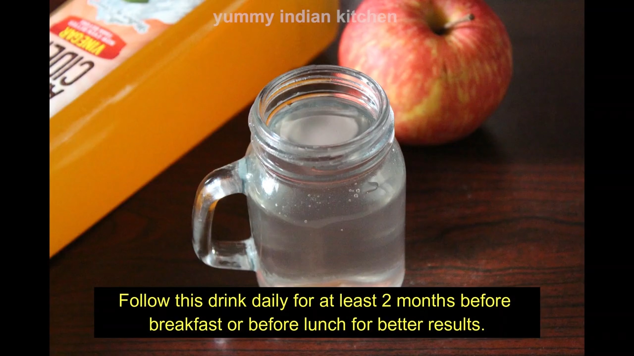 apple cider mixed with water jar placed on the table
