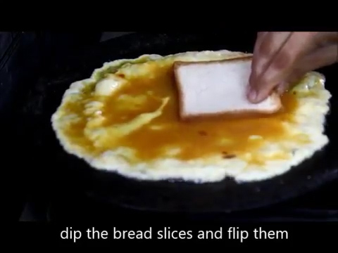 bread slice dipped in the cooking omelette