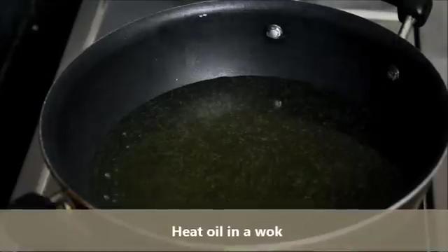 Heating oil in a wok