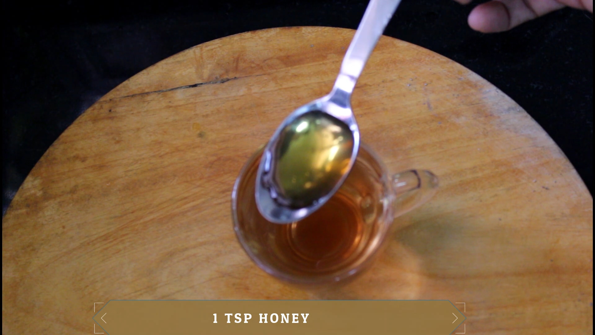 honey in a spoon to add into the drink
