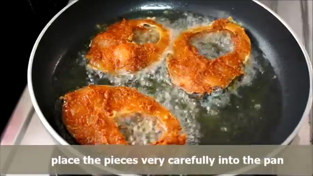 Placing the fish pieces carefully and cooking them for 5 minutes