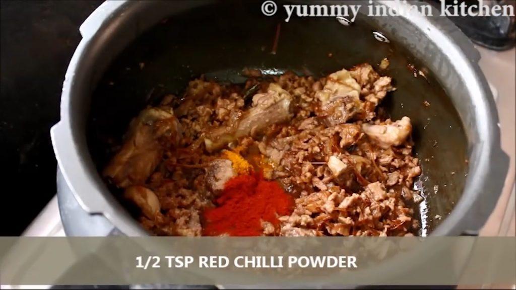 Adding salt, turmeric powder, red chilli powder