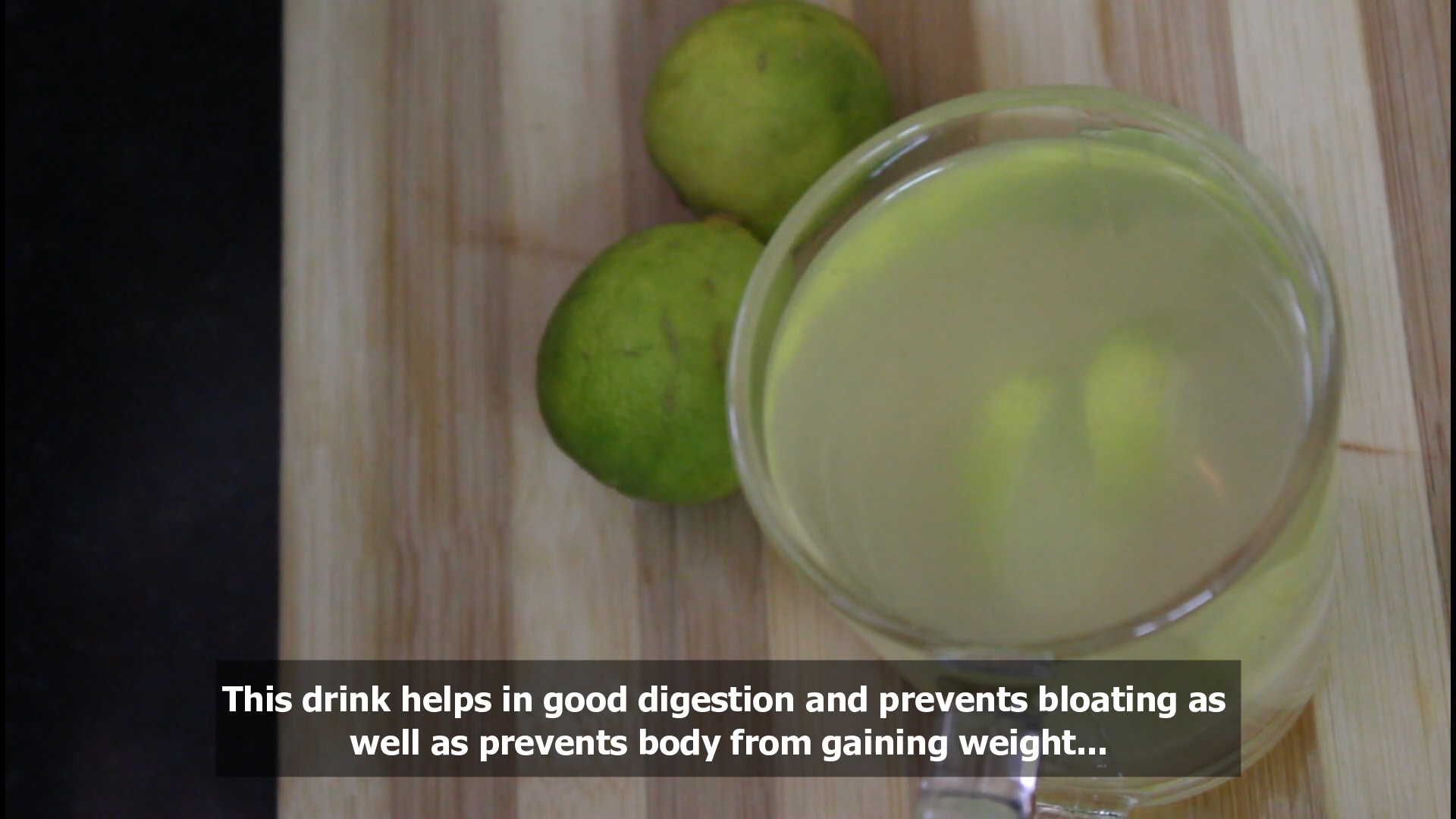 showing the glass with a text to drink it to prevent bloating and to aid digestion
