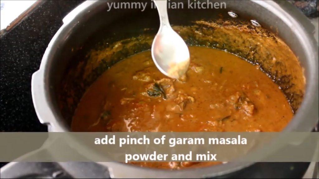 adding garam masala in mutton kulambu