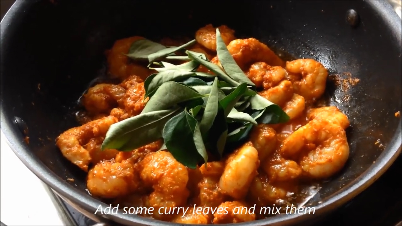 fresh curry leaves added into the cooking prawns