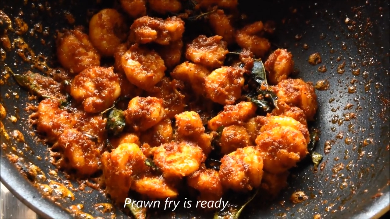 finished step of prawn fry or vepudu in the wok in south indian style
