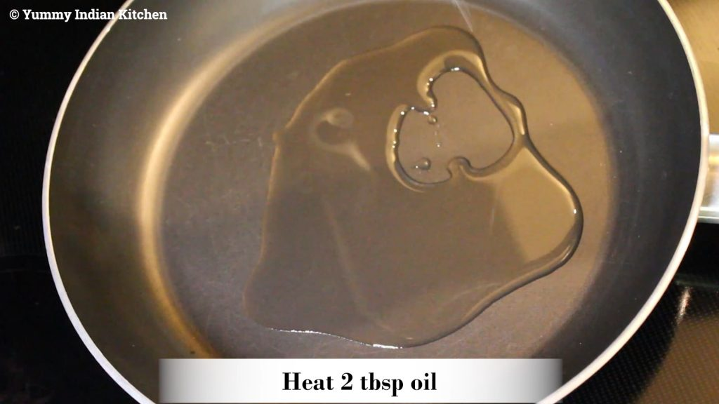 adding oil and heating in a pan