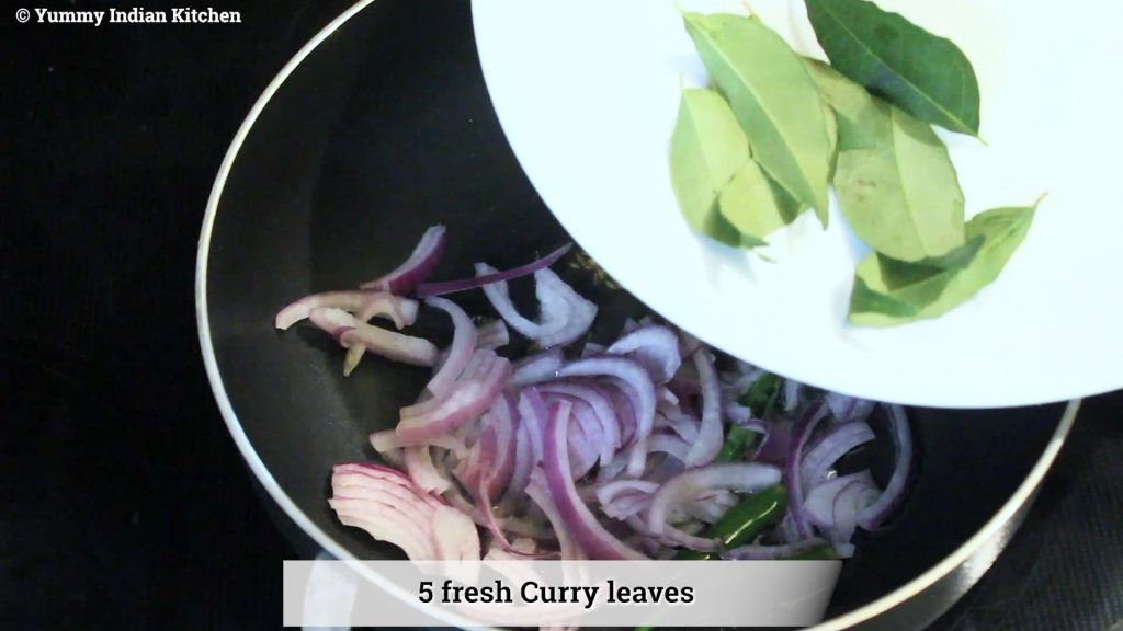 adding fresh curry leaves