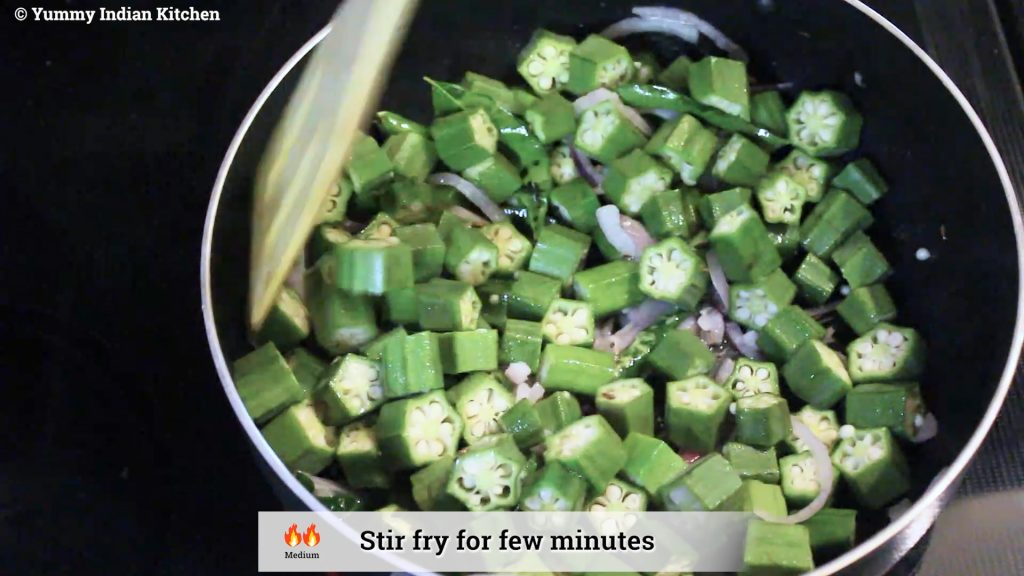 Adding the cut bhindi pieces into it and mix