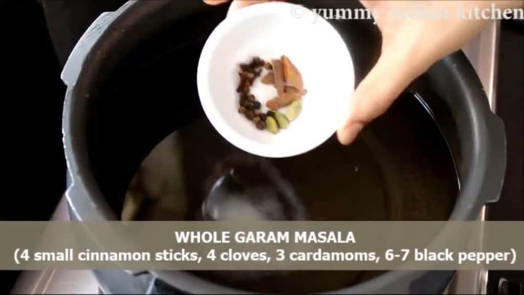 adding water, salt as per taste and whole garam masala