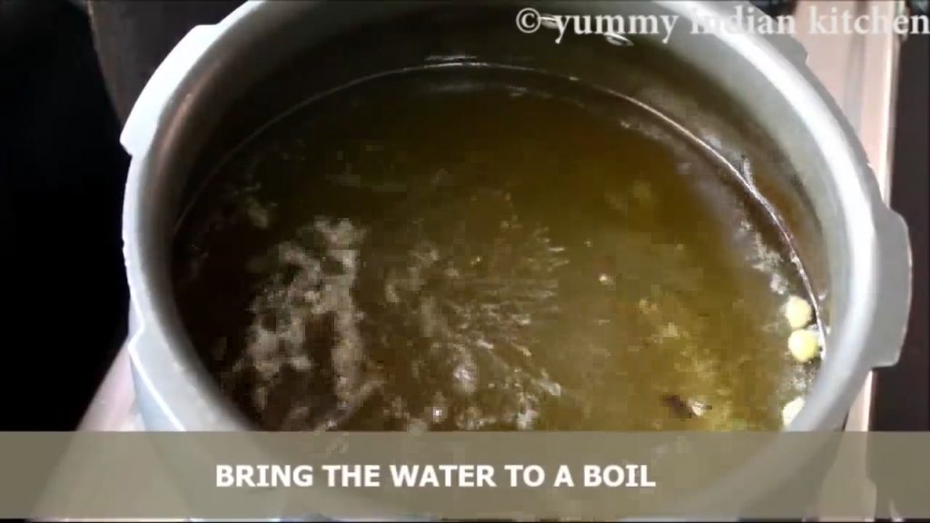 Adding caraway seeds and bringing the water to a boil