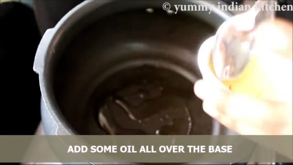 Take a handi, add little oil all over the base.
