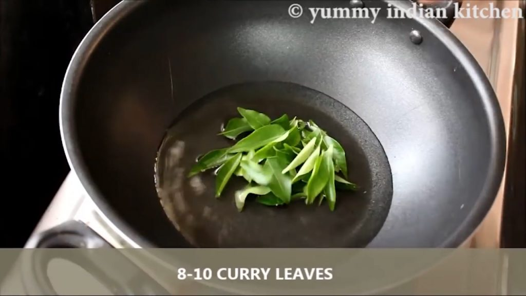 Adding curry leaves to crackle