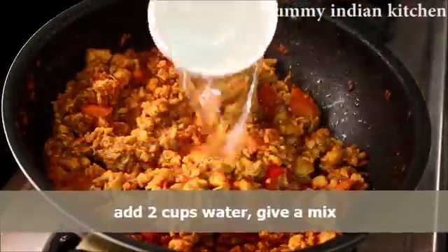 Adding water and cooking the keema