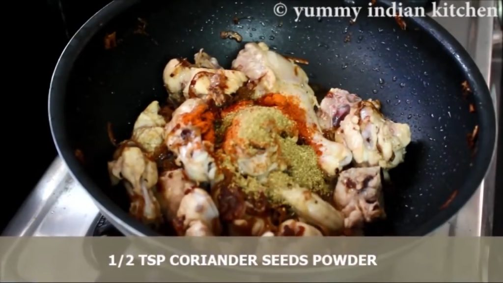adding dry spices into the chicken masala