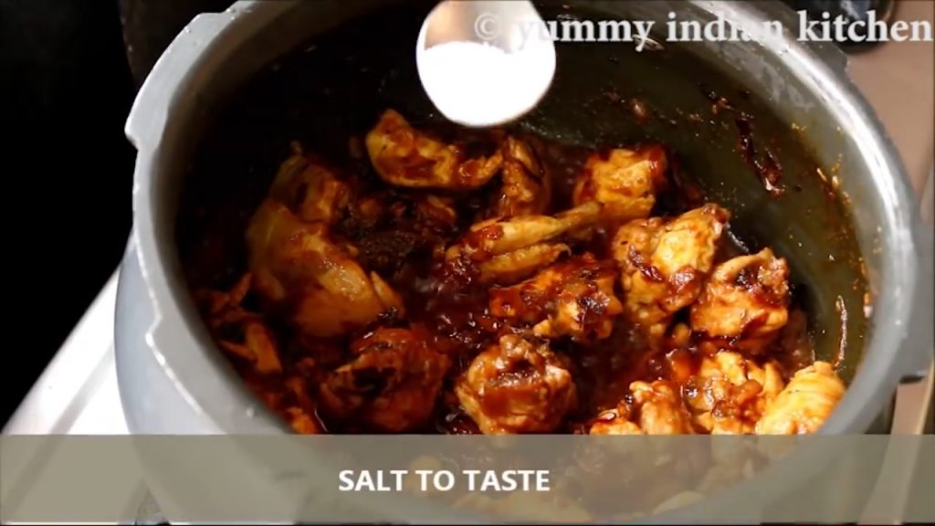 adding spices to the chicken