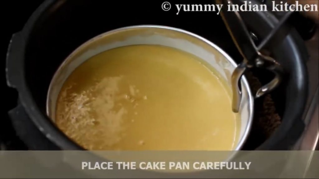 Place the cake pan inside the cooker