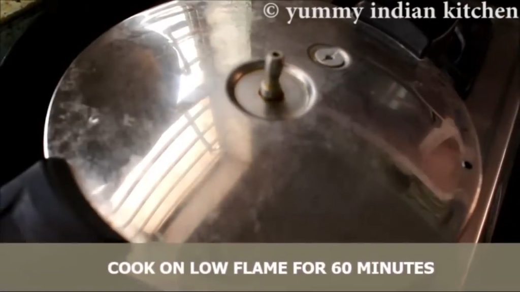 Cooking the cooker cake on low flame for 50-60 minutes