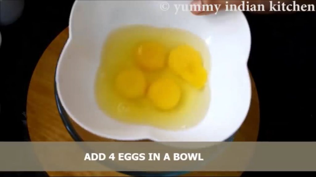 adding 4 eggs to whisk well