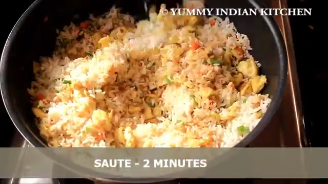 stir-frying the egg fried rice