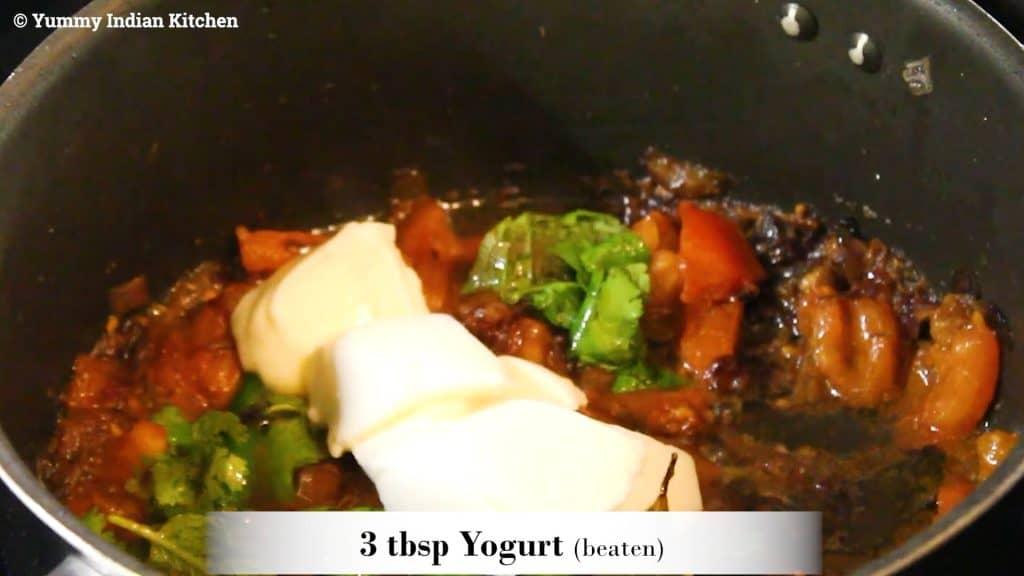 Adding beaten yogurt to the egg pulao