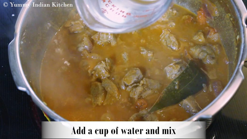 Adding a cup of water and mixing.