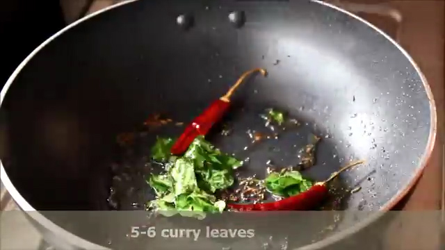 Add dried red chillies and adding curry leaves