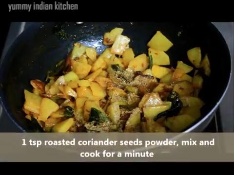 adding roasted coriander seeds powder