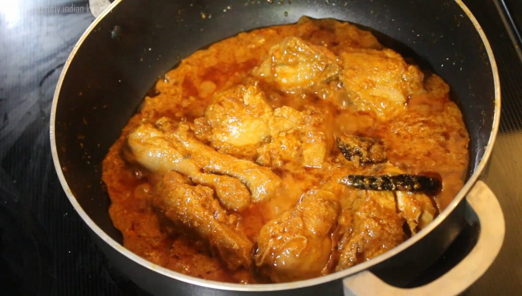 Cooking the chicken curry for few minutes