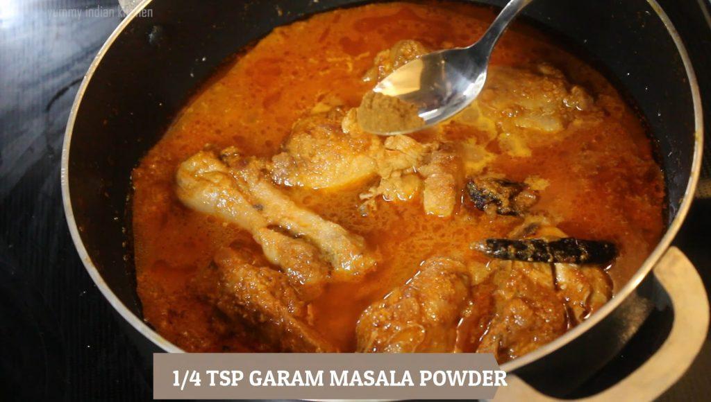 adding garam masala powder to punjabi chicken