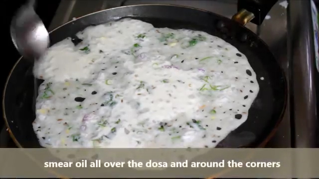 smearing oil all over the rava dosa