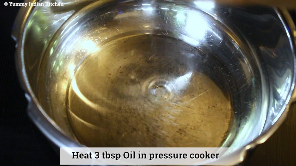 add oil to cooker and heating it