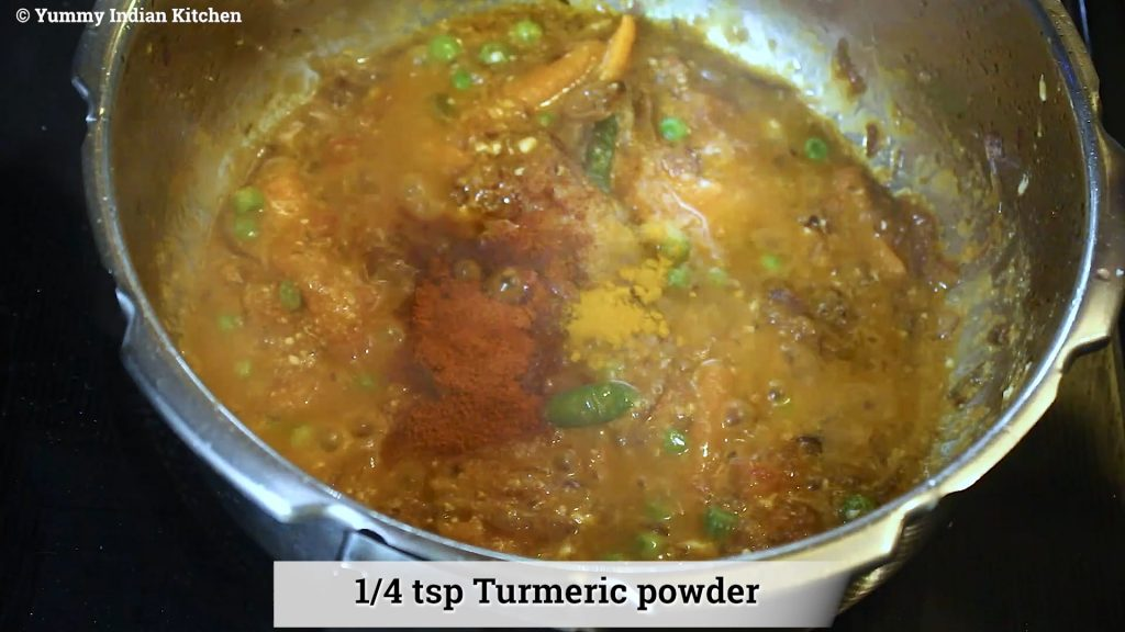 adding dry spices to tomato biryani
