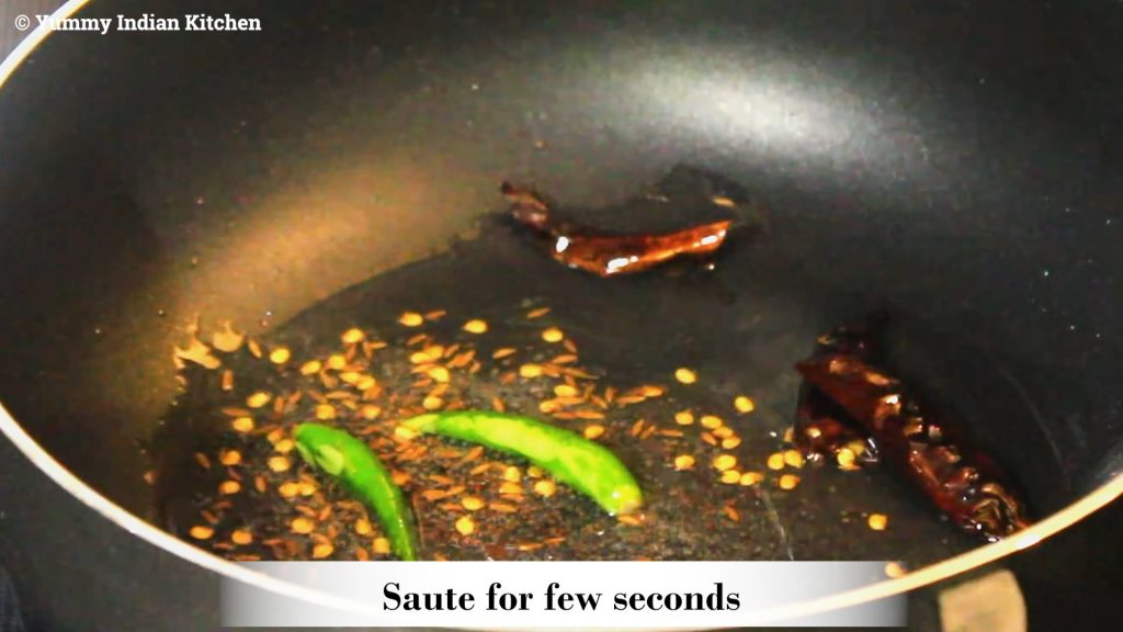 Add slit green chilies, dried red chilies, saute for few seconds