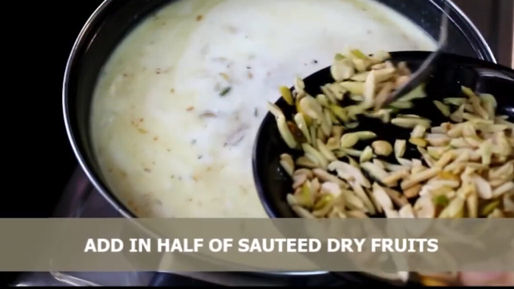 adding fried dry fruits into the sheer khurma