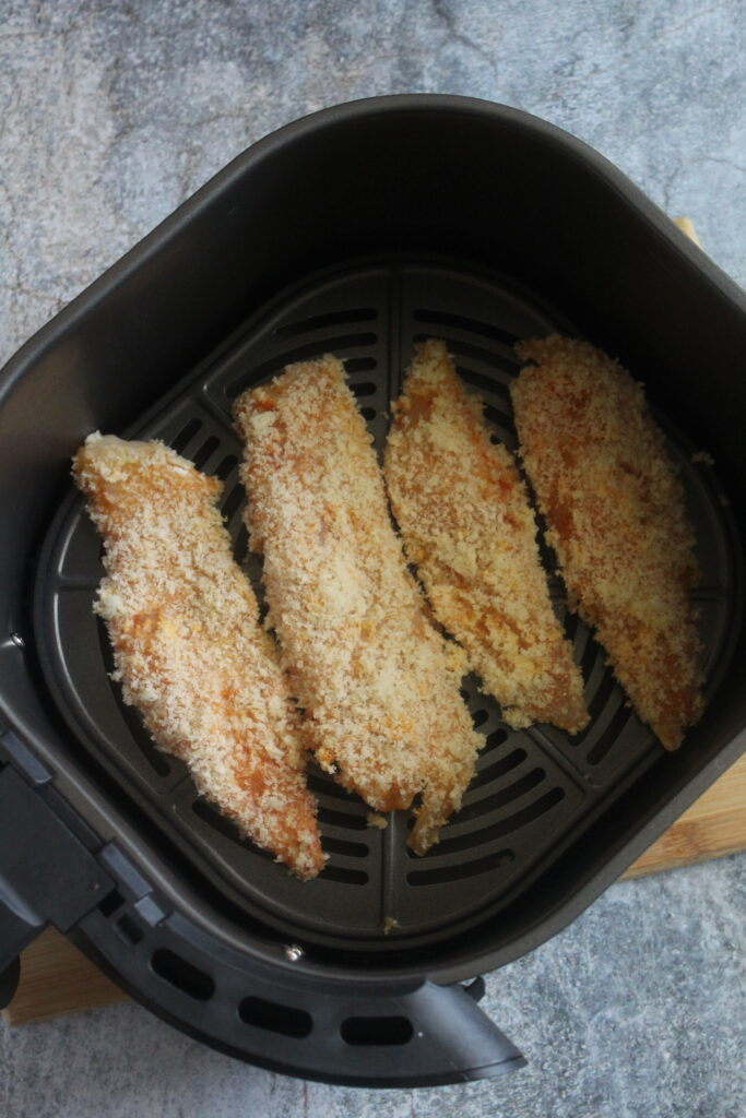 place the coated fish pieces into the air fryer