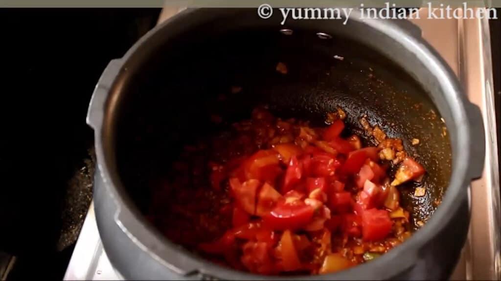Adding chopped tomatoes