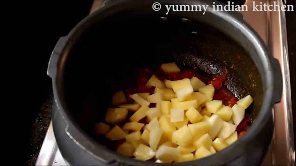 Adding diced potatoes