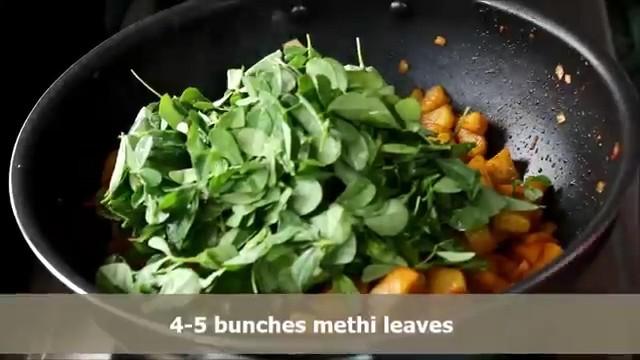 Adding fresh methi leaves