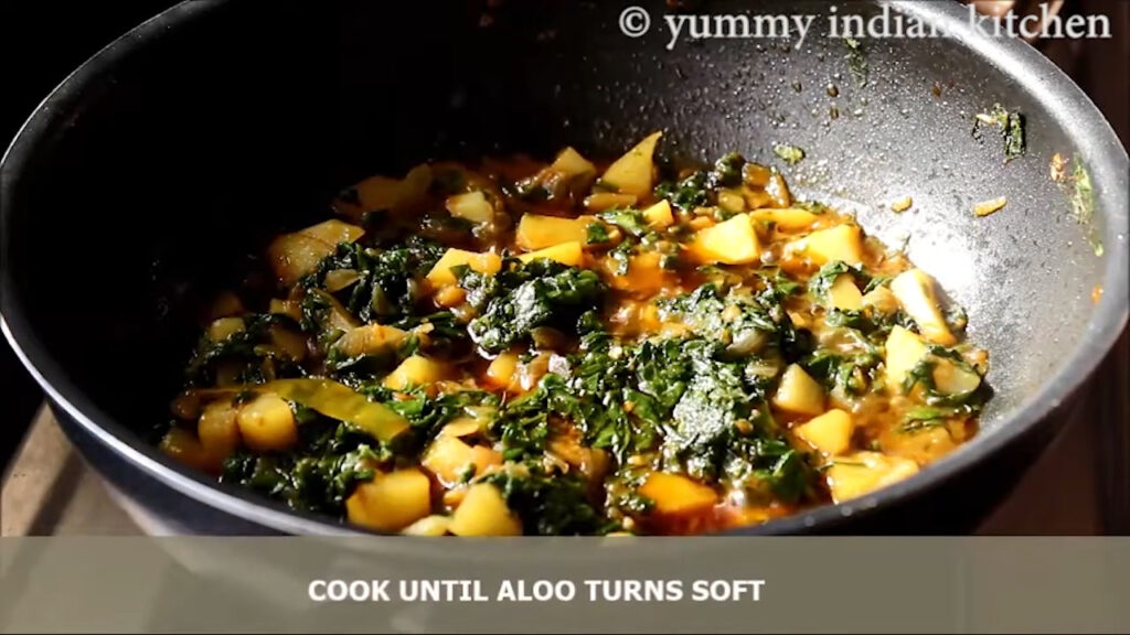 Adding chopped coriander leaves and cooking