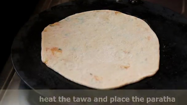 cooking the aloo paratha