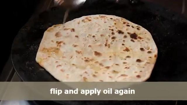 cook both sides of aloo paratha