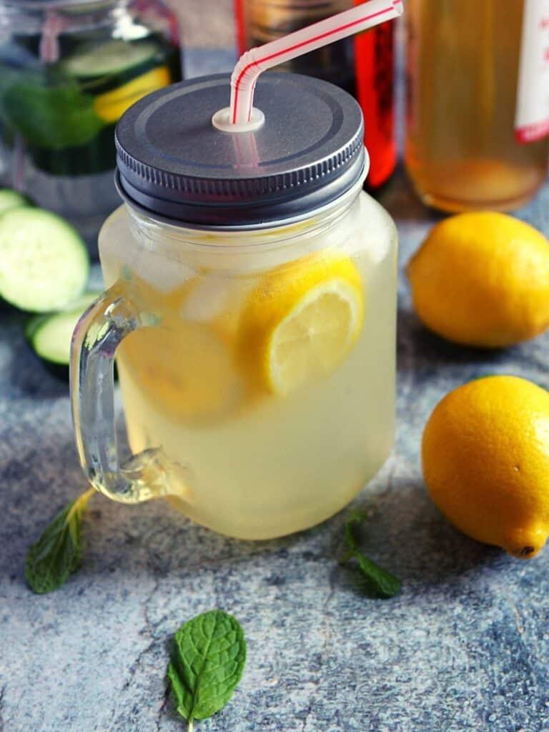 apple cider vinegar and lemon detox drink served in a mason jar
